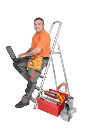 mr: Builder typing on a laptop