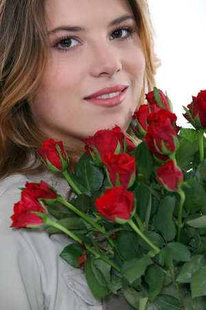 Young woman with a bunch of red roses Stock Photo - 13500285