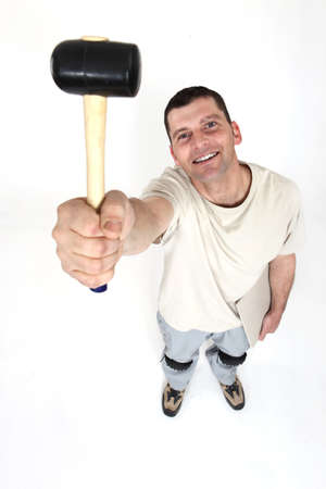 40 45: Handyman holding a mallet in the air