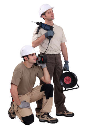 distraction: Tradesmen holding their tools