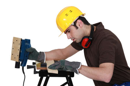 Man with an electrical sander photo