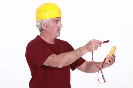 Electrician using multimeter photo