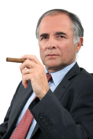 moneyed: Executive with a cigar Stock Photo