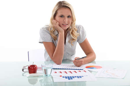 young female employee drawing charts photo