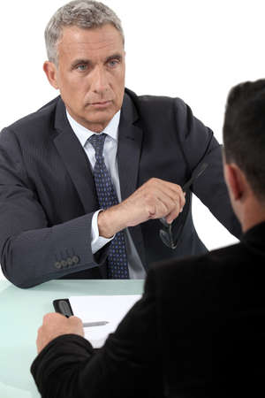 Businessman listening to a colleague photo