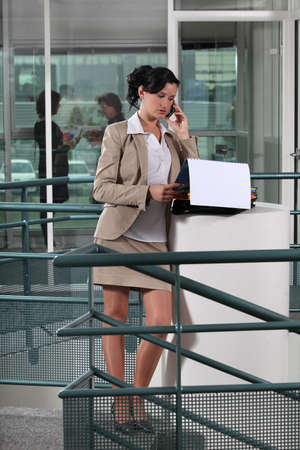 Businesswoman on the phone outside an office photo