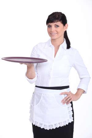 Waitress with an empty tray photo