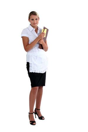 affability: blonde waitress holding menu and a pen