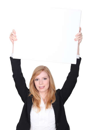 captivate: young woman holding an empty advertising board