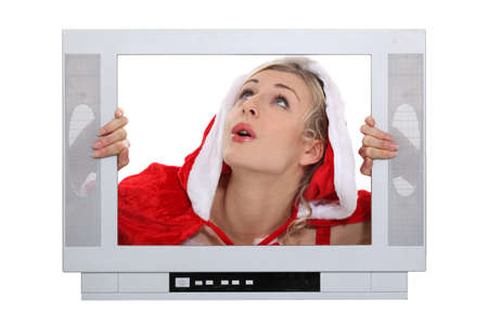 Woman with Christmas layer frame behind TV photo
