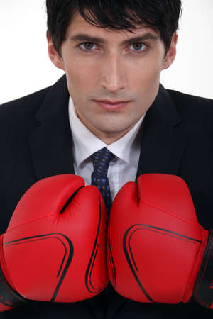 certitude: young businessman with boxing gloves