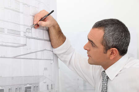 40 45: Architect working on a blueprint