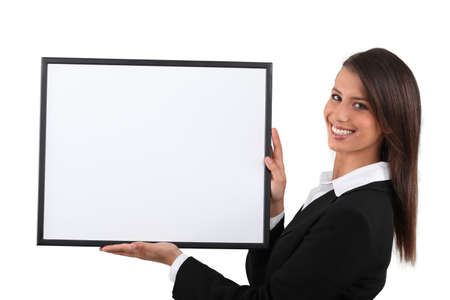 publicity: Young woman holding a publicity poster Stock Photo