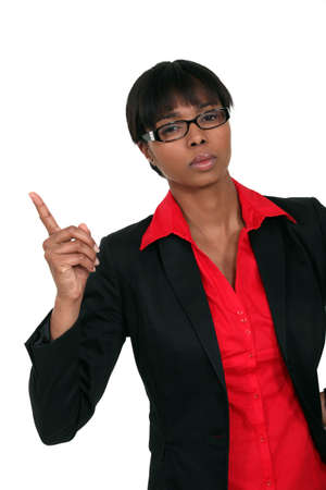 wag: Businesswoman wagging her finger