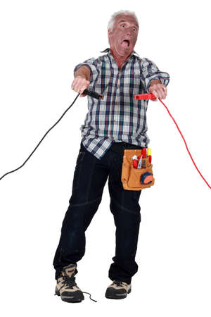 Man getting an electric shock from jump leads Stock Photo - 13458512