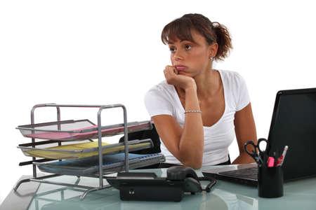 indifferent: Secretary bored at work