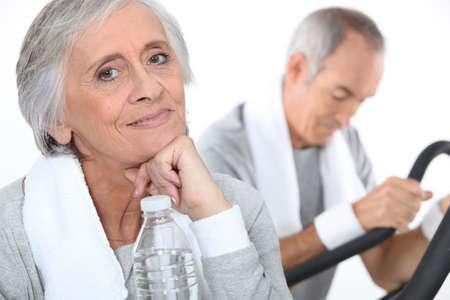 couple exercising: senior couple training