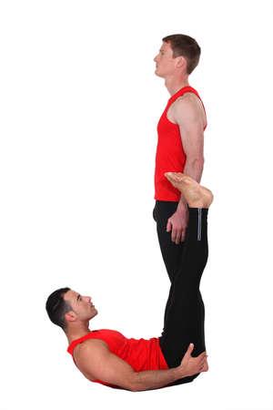 male mannequin: Men in gymwear making the letter J