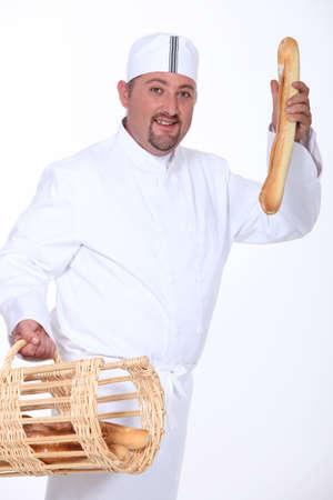 french bread: baker Stock Photo