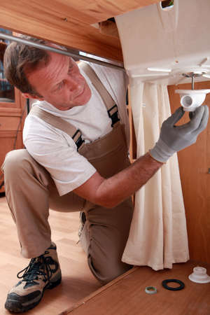 Plumber repairing faucet piping Stock Photo - 13542335