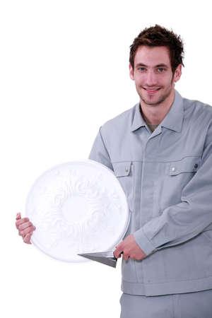 plasterer holding a pattern photo