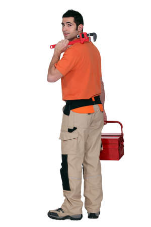 arrive: A tradesman arriving at work Stock Photo