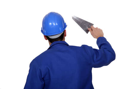 Worker holding a trowel photo