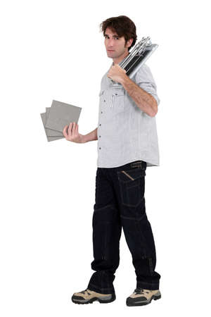 tiler holding tiles in studio background photo