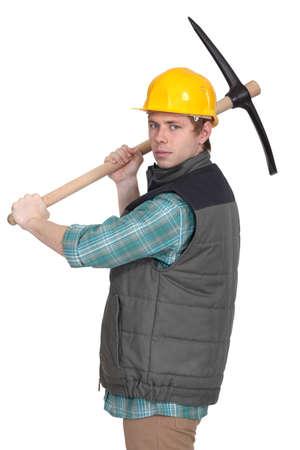 pickaxe: Angry tradesman with a pickaxe Stock Photo