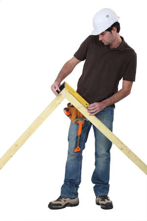 joiner: Worker using a right angle ruler to measure an angle Stock Photo