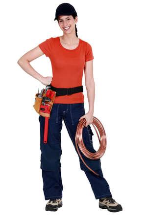 tradeswoman: Tradeswoman holding a wire Stock Photo