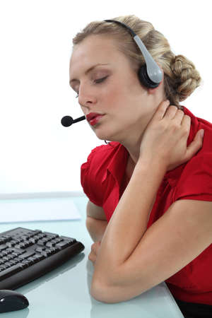neck pain: Telephone operator with neck pain