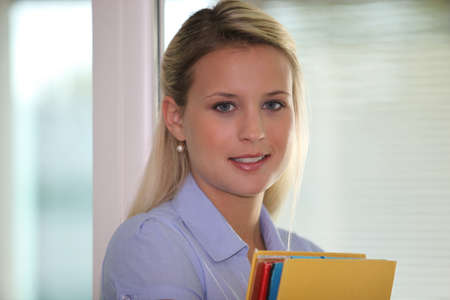 young businesswoman holding folders Stock Photo - 13541856