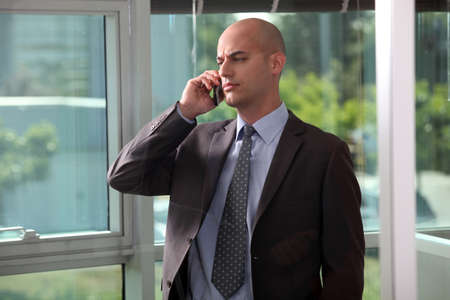 Serious businessman making call photo