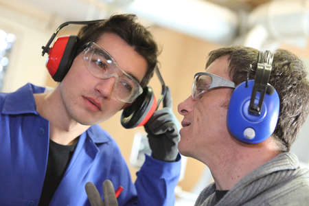 Men wearing ear defenders Stock Photo - 13542348