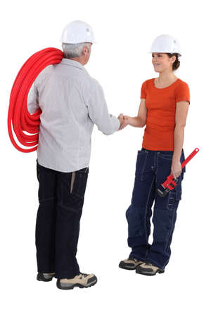 non verbal: Tradespeople shaking hands