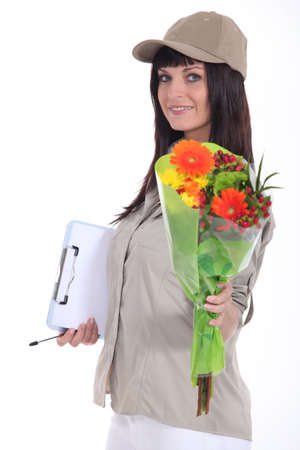 Woman delivering bouquet of flowers photo