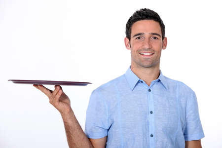 giving back: 35 years old waiter wearing a casual shirt Stock Photo