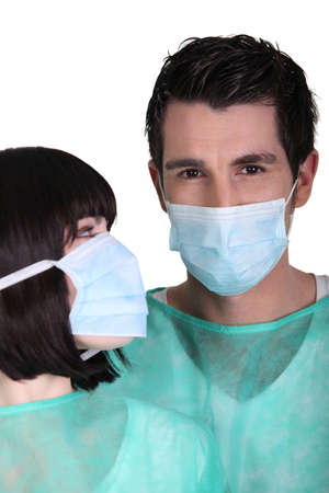 Surgeons wearing face masks Stock Photo - 13541977