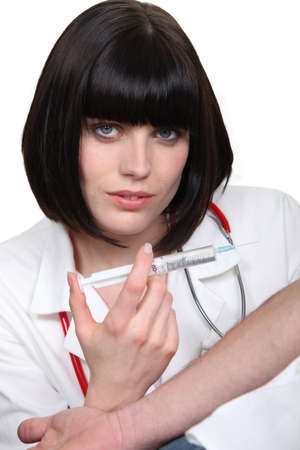 a nurse giving an injection photo