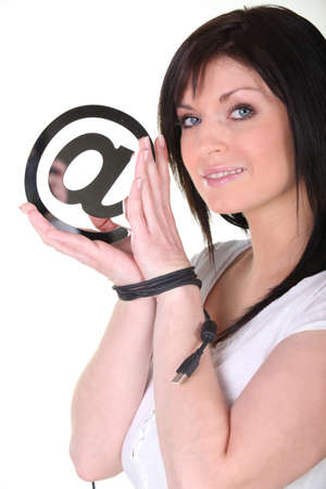 e mailing: Brunette with hands tied-together, holding at symbol