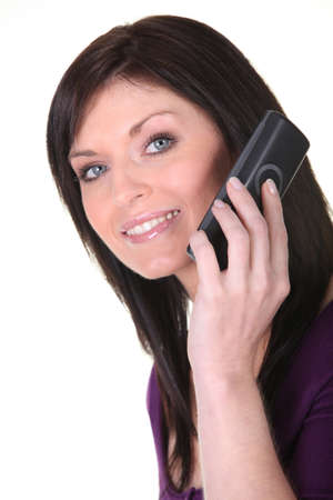 Brunette woman on the phone Stock Photo - 13541769