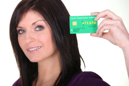 Woman showing French Carte Vitale Stock Photo - 13542074