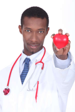 Plastic heart being held by a hospital doctor photo