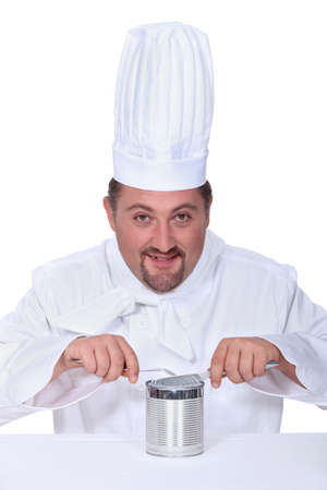 circumstances: Chef cutting into tin can Stock Photo