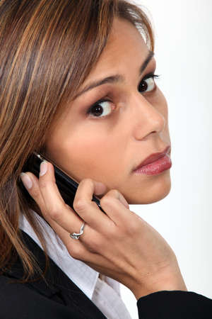 telecoms: Businesswoman with mobile telephone