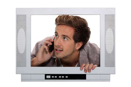 Concept shot of a man on the telephone inside a television screen photo