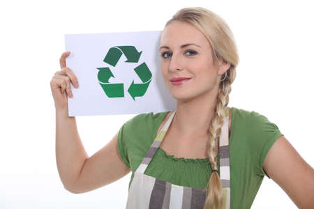 blonde woman showing the recycling symbol photo