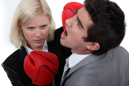 Woman executive punching her colleague  photo