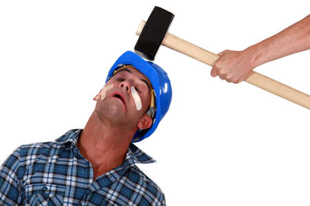 work injury: Injured tradesman being hit over the head with a mallet